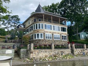 lake view of three story bed and breakfast with new exterior paint
