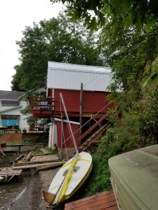 Red boathouse with new galvanized metal roof