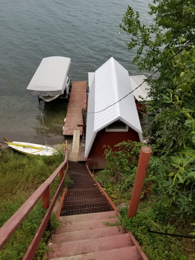 Red boathouse with galvanized metal roof