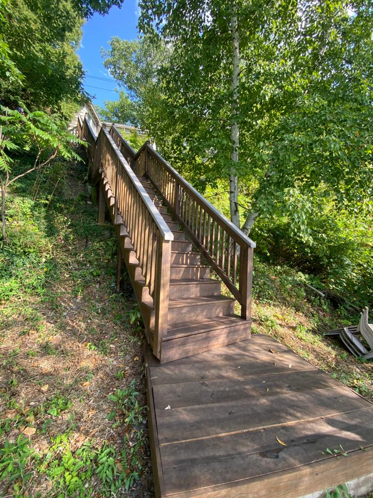 Newley stianed stairs leading to lake