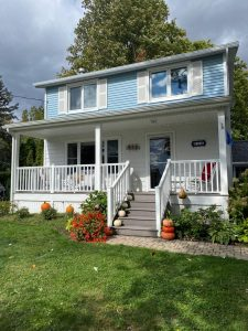 """front of home with blue siding """"before"""""""