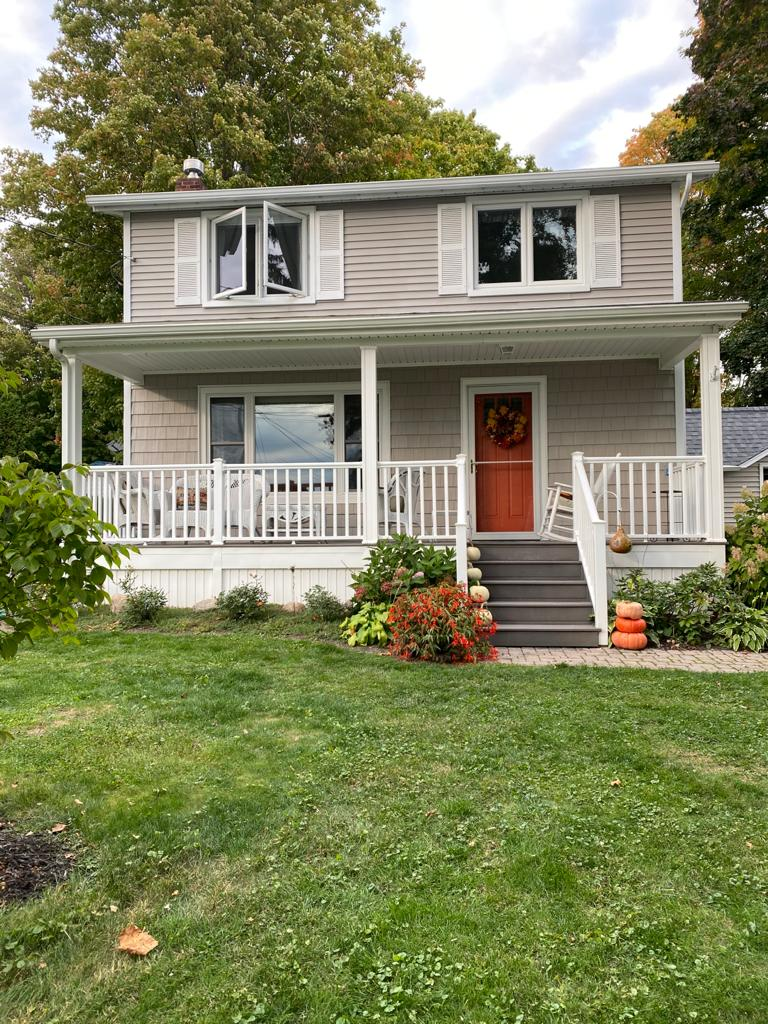 front of home with tan siding