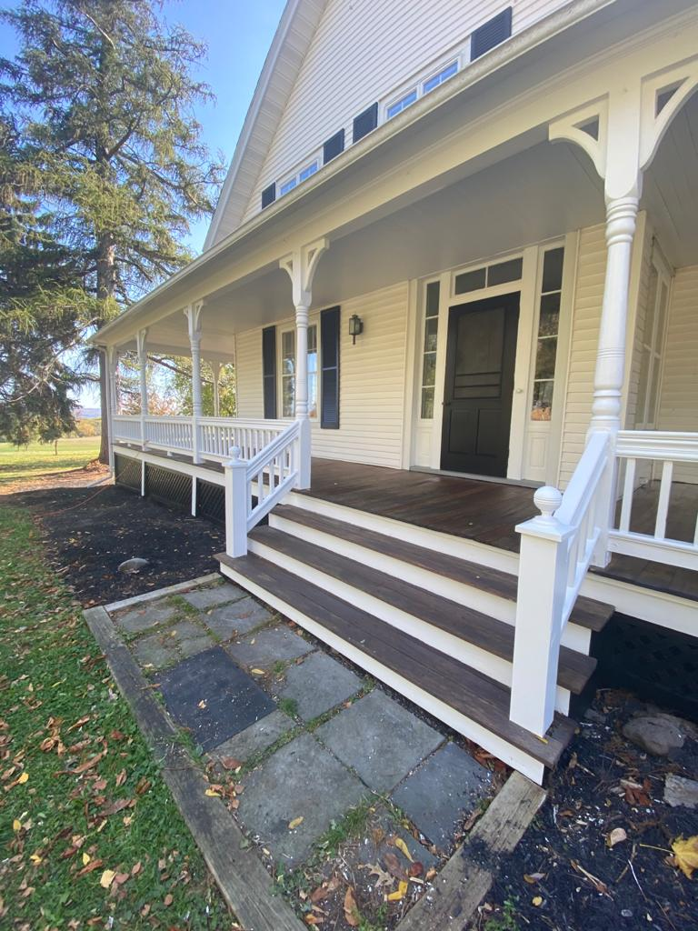 Front porch with new mahogany stain