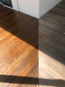 contrast between stained porch boards